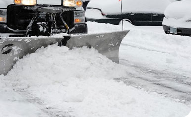 snow plowing a parking lot